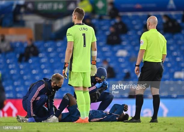 Bukayo Saka of Arsenal receives medical treatment during the Premier League match between Leeds United and Arsenal at Elland Road on November 22 2020...