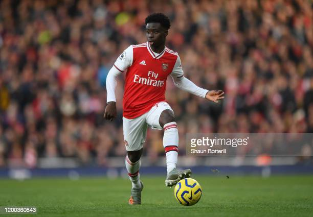 Bukayo Saka of Arsenal runs with the ball during the Premier League match between Arsenal FC and Sheffield United at Emirates Stadium on January 18,...