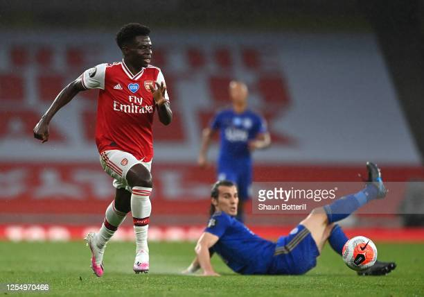 Bukayo Saka of Arsenal runs with the ball during the Premier League match between Arsenal FC and Leicester City at Emirates Stadium on July 07 2020...