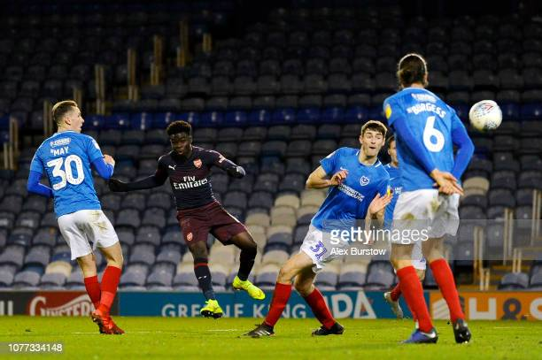 Bukayo Saka of Arsenal scores his team's first goal during the Checkatrade Trophy match between Portsmouth and Arsenal U21 at Fratton Park on...