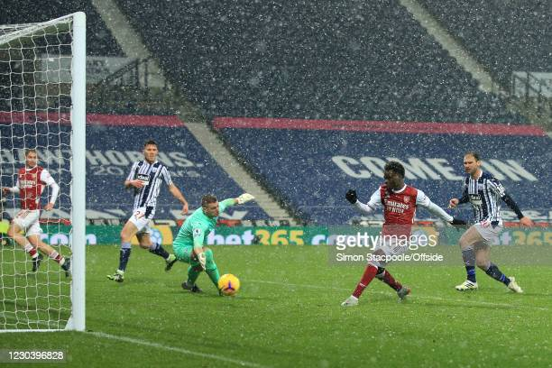 Bukayo Saka of Arsenal scores their 2nd goal during the Premier League match between West Bromwich Albion and Arsenal at The Hawthorns on January 2,...