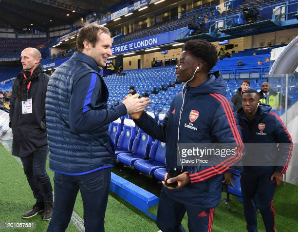 Bukayo Saka of Arsenal shakes hands with Petr Cech former Arsenal and Chelsea player before the Premier League match between Chelsea FC and Arsenal...
