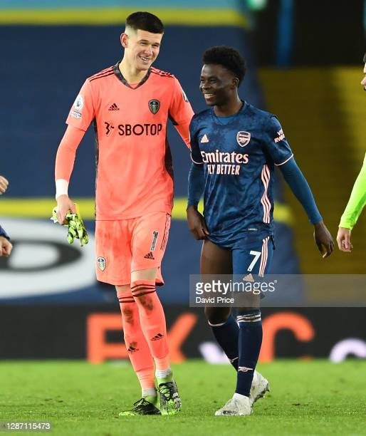 Bukayo Saka of Arsenal shares a joke with Illan Meslier of Leeds after the Premier League match between Leeds United and Arsenal at Elland Road on...