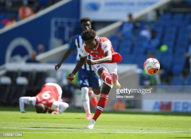 Bukayo Saka of Arsenal shoots during the Premier League match between Brighton Hove Albion and Arsenal FC at American Express Community Stadium on...