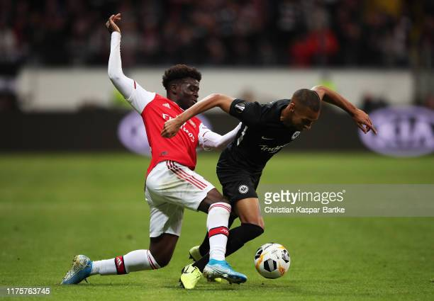 Bukayo Saka of Arsenal tackles Djibril Sow of Eintracht Frankfurt during the UEFA Europa League group F match between Eintracht Frankfurt and Arsenal...