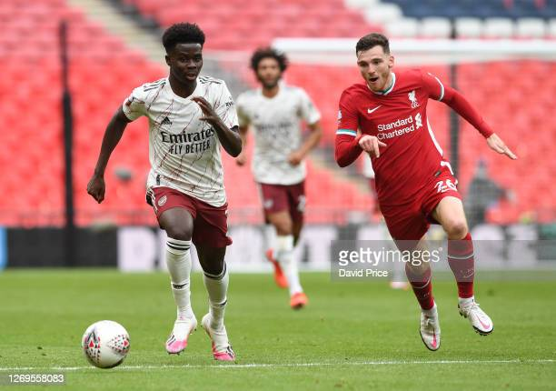 Bukayo Saka of Arsenal takes on Andrew Robertson of Liverpool during the FA Community Sheild match between Arsenal and Liverpool at Wembley Stadium...
