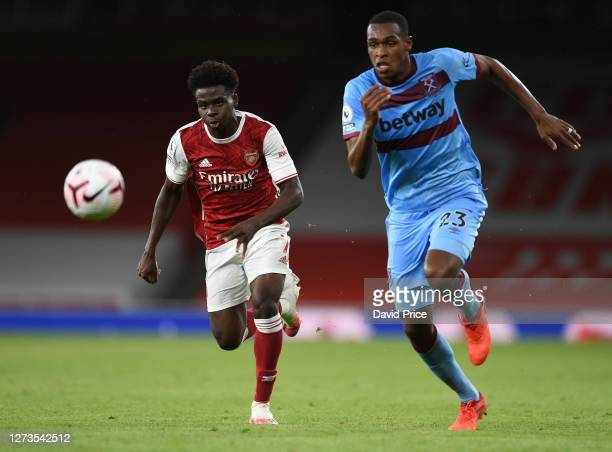 Bukayo Saka of Arsenal takes on Issa Diop of West Ham during the Premier League match between Arsenal and West Ham United at Emirates Stadium on...