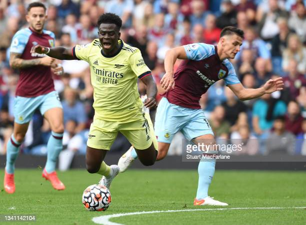 Bukayo Saka of Arsenal tripped by Ashley Westwood of Burnley during the Premier League match between Burnley and Arsenal at Turf Moor on September...