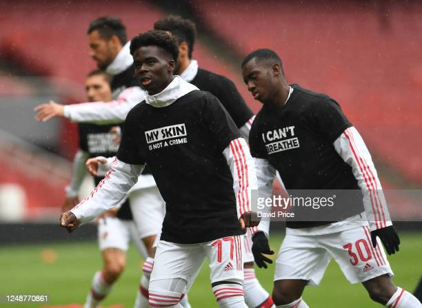Bukayo Saka of Arsenal warms up before the friendly match between Arsenal and Brentford at Emirates Stadium on June 10 2020 in London England