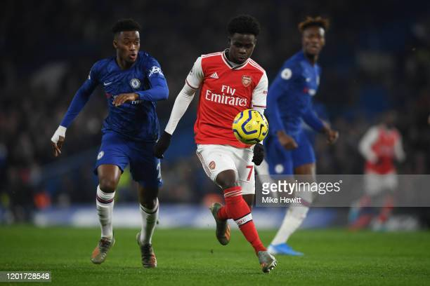Bukayo Saka of Arsenalgets away from Callum HudsonOdoi of Chelsea during the Premier League match between Chelsea FC and Arsenal FC at Stamford...