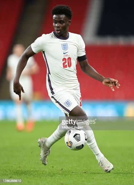 Bukayo Saka of Englad runs with the ball during the UEFA Nations League group stage match between England and Iceland at Wembley Stadium on November...