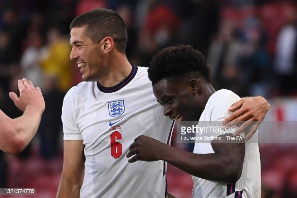 Bukayo Saka of England celebrates with team mate Conor Coady after scoring their side's first goal during the international friendly match between...