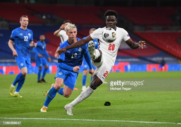 Bukayo Saka of England is challenged by Albert Guomundsson of Iceland during the UEFA Nations League group stage match between England and Iceland at...