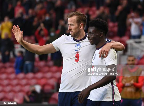 Bukayo Saka of England is congratulated on scoring the opening goal by Harry Kane during the international friendly match between England and Austria...