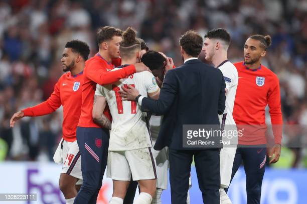 Bukayo Saka of England is consoled by Ben White, Kalvin Phillips, Gareth Southgate, Head Coach of England, Declan Rice and Dominic Calvert-Lewin of...