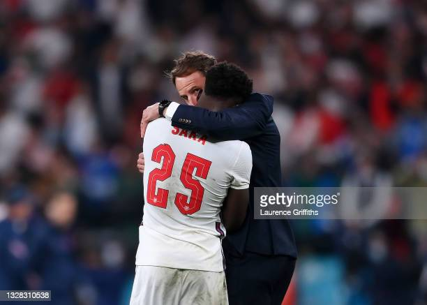Bukayo Saka of England is consoled by Head Coach, Gareth Southgate after his penalty miss during the UEFA Euro 2020 Championship Final between Italy...