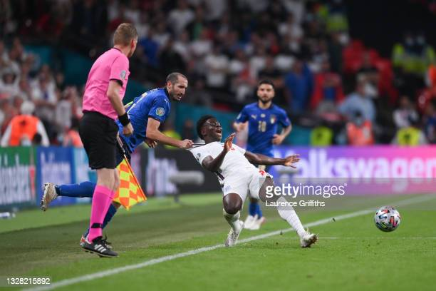 Bukayo Saka of England is fouled by Giorgio Chiellini of Italy during the UEFA Euro 2020 Championship Final between Italy and England at Wembley...