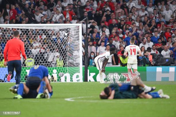 Bukayo Saka of England looks dejected after missing the decisive penalty in a penalty shoot out, leading to Italy's victory in the UEFA Euro 2020...