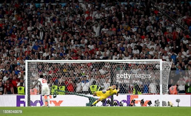 Bukayo Saka of England misses his team's fifth penalty in a penalty shoot out which is saved by Gianluigi Donnarumma of Italy during the penalty...