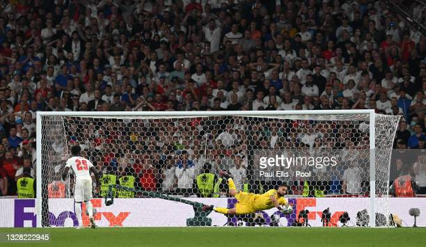Bukayo Saka of England misses his team's sixth penalty in a penalty shoot out which is saved by Gianluigi Donnarumma of Italy during the penalty...