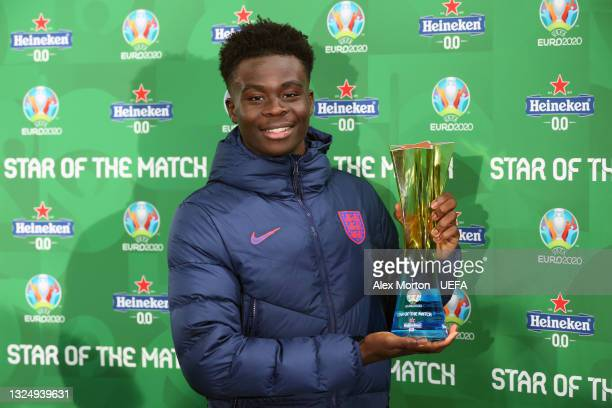 """Bukayo Saka of England poses for a photograph with their Heineken """"Star of the Match"""" award after the UEFA Euro 2020 Championship Group D match..."""