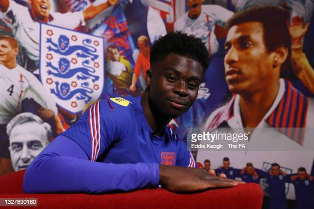 Bukayo Saka of England poses for a portrait during a Q and A at St George's Park on July 09, 2021 in Burton upon Trent, England.