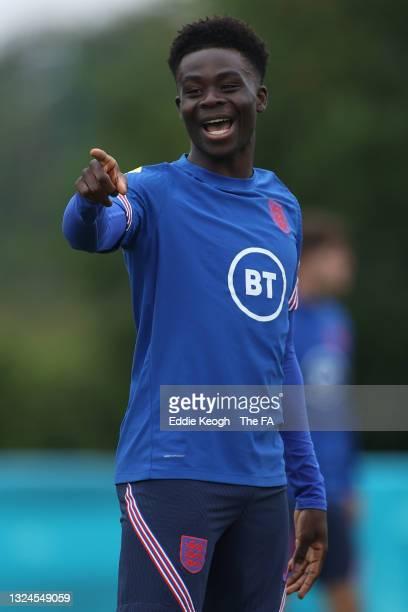 Bukayo Saka of England reacts during the England Training Session at Tottenham Hotspur Training Ground on June 20, 2021 in Burton upon Trent, England.