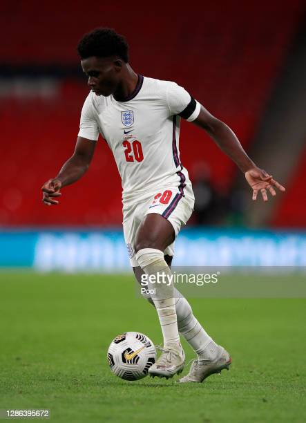 Bukayo Saka of England runs with the ball during the UEFA Nations League group stage match between England and Iceland at Wembley Stadium on November...