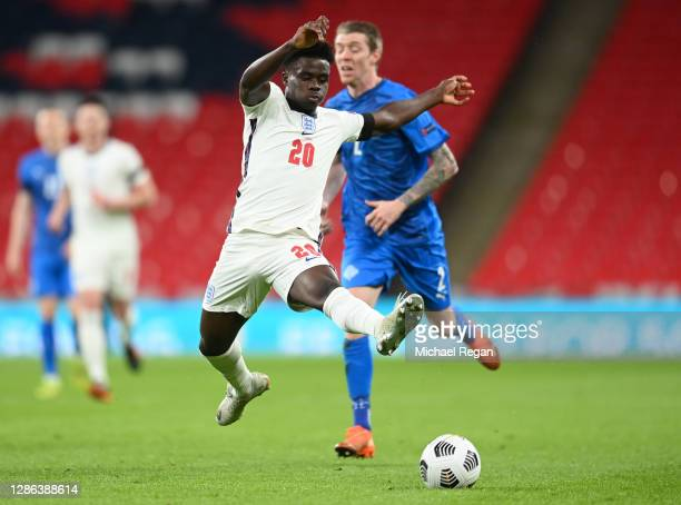 Bukayo Saka of England stretches to control the ball during the UEFA Nations League group stage match between England and Iceland at Wembley Stadium...