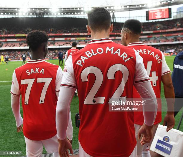 Bukayo Saka Pablo Mari and PierreEmerick Aubameyang of Arsenal walk out for the 2nd half during the Premier League match between Arsenal FC and West...