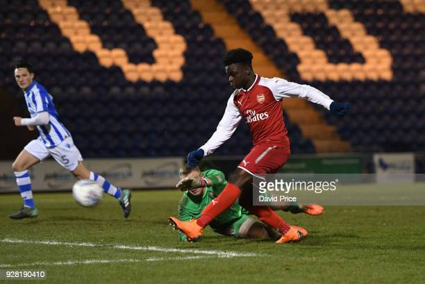 Bukayo Saka scores Arsenal's 3rd goal under pressure from Harry Seaden of Colchester during the FA Youth Cup match between Colchester United and...
