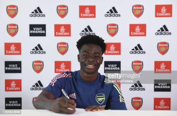 Bukayo Saka signs a new long term contract at Arsenal at London Colney on July 01, 2020 in St Albans, England.