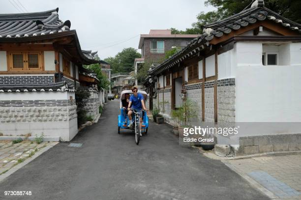 bukchon hanok vilage in seoul - rickshaw stock photos and pictures