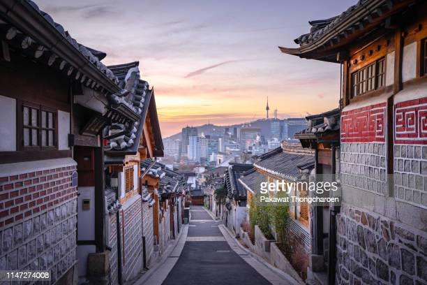 bukchon hanok village at sunrise with n seoul tower as background, seoul, south korea - korea stock pictures, royalty-free photos & images