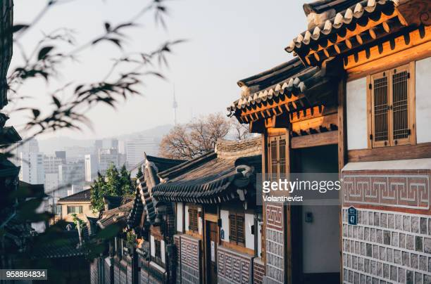 bukchon hanok village street at sunrise, seoul, south korea - seoul stock pictures, royalty-free photos & images