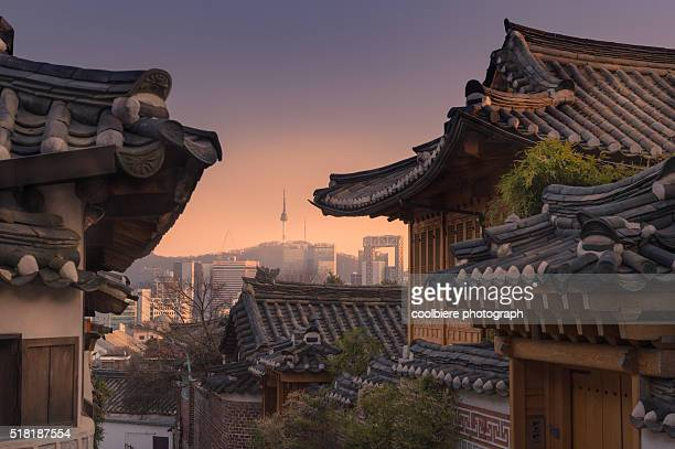Bukchon Hanok village with Seoul city background