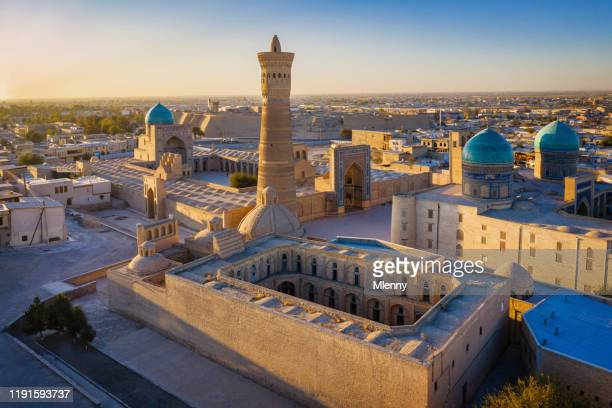 bukhara sunset poi kalon minaret mir arab madrasah in uzbekistan - muziek stock pictures, royalty-free photos & images