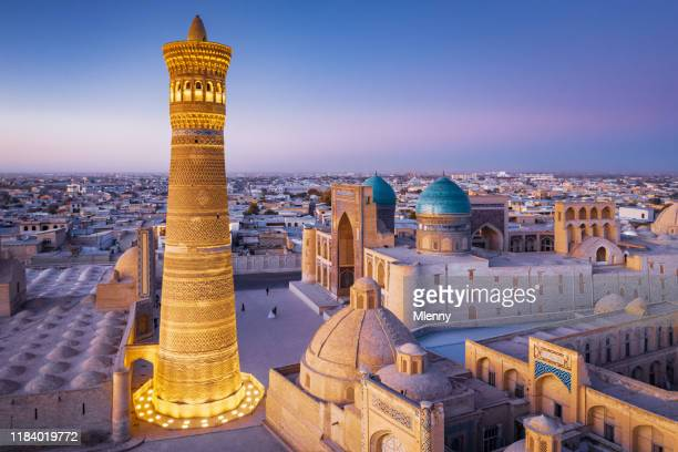 bukhara uzbekistan kalyan minaret and madressa sunset twilight - muziek stock pictures, royalty-free photos & images