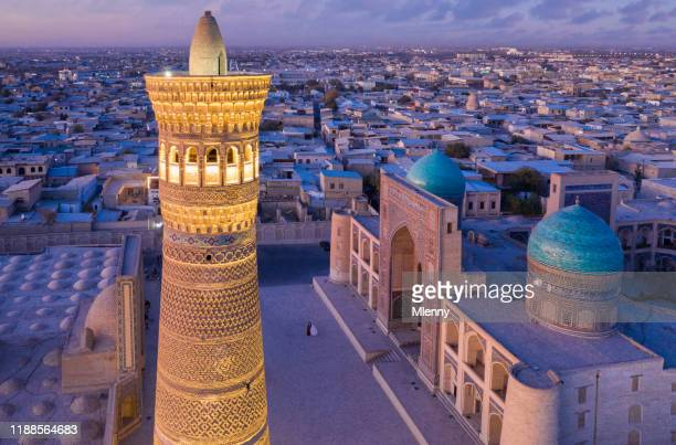bukhara uzbekistan kalyan minaret po-i-kalyan sunset twilight - muziek stock pictures, royalty-free photos & images