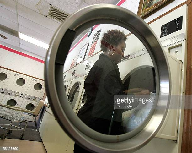 Bukola Abioye drops items into a commercial Maytag clothes dryer in a laundromat June 22 2005 in Glenview Illinois Chinese appliance maker Haier has...