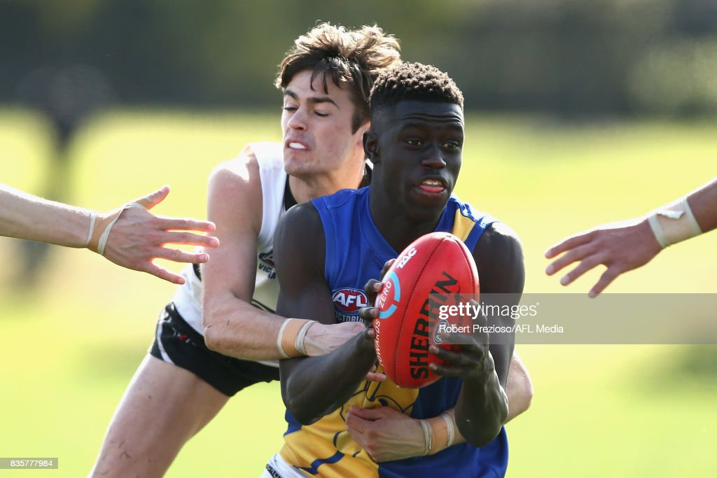 Buku Khamis of the Western Jets is tackled during the TAC Cup round 16 match between the Northern Knights and the Western Jets at RAMS Arena on August 19, 2017 in Melbourne, Australia.