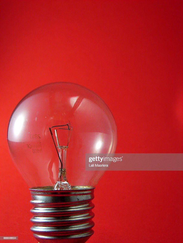 Bulb against red  background  : Stock Photo