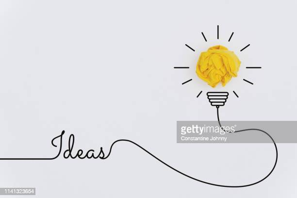 bulb idea concepts with yellow crumpled paper ball - idea fotografías e imágenes de stock