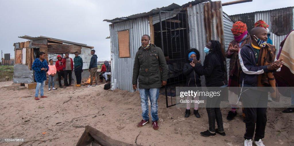 Bulelani Qholani speaks outside his shack on July 02, 2020