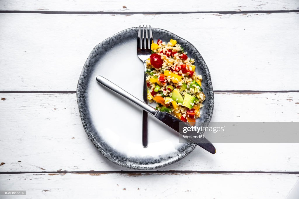 Bulgar salad on round plate, symbol for intermittent fasting : Stock Photo