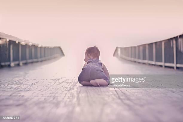 Bulgaria, Baby boy (6-11 months) crawling on bridge