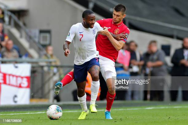 Bulgaria defender Strahil Popov battles with England forward Raheem Sterling during the UEFA Euro 202 Group A Qualifying match between England and...
