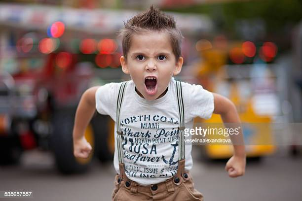 bulgaria, little boy (4-5) roaring - roaring stock photos and pictures