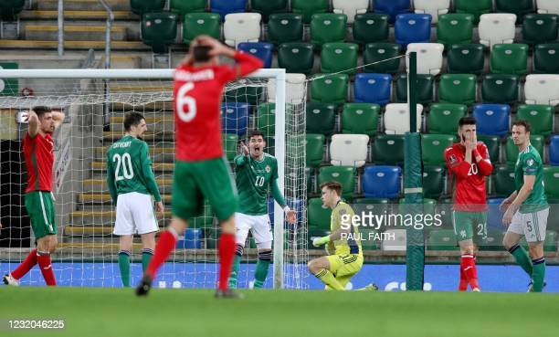 Bulgaria players react after missing an opportunity to score during the FIFA World Cup Qatar 2022 Group C qualification football match between...