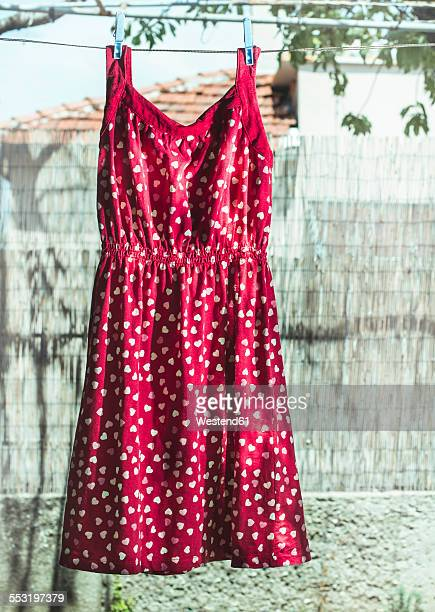 Bulgaria, red dress with heart shapes on laundry